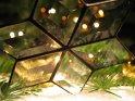Foto von einem Bleikristallstern in einer Adventszene. In den Gläsern spiegeln sich zahlreiche Kerzen.    Dieses Motiv findet sich seit dem 02. Dezember 2005 in der Kategorie Weihnachtsbilder.