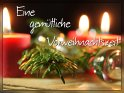 Grußkarte für die Adventszeit mit dem Spruch Eine gemütliche Vorweihnachtszeit. Das Motiv der Karte bilden drei rote brennende Kerzen, ein Tannenzweig und mehrere Glaskugeln.