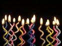 16 geschwungene Kerzen