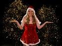 Frau im Weihnachtskostüm mit Sternenregen